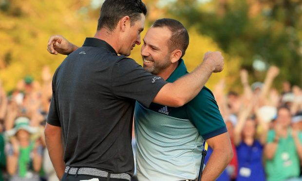 Justin Rose (L) of England congratulates Sergio Garcia (R) of Spain after Garcia won on the first playoff hole during the final round of the 2017 Masters Tournament at Augusta National Golf Club (Andrew Redington/Getty Images)