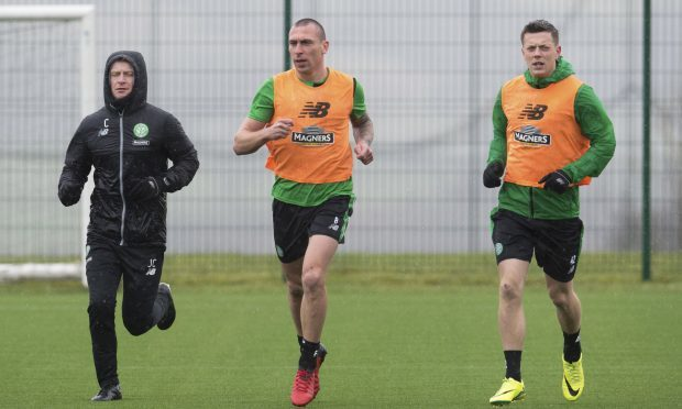 Celtic's Scott Brown (centre) and Callum McGregor (SNS)