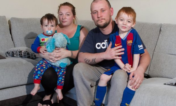 Gemma Duncan with partner Grant Finnigan and son Calib, was pregnant with second son Brayden when the conman tried to rip them off (DC Thomson / Chris Austin)