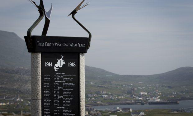 The War Memorial statue, which overlooks Castlebay (Andrew Cawley)