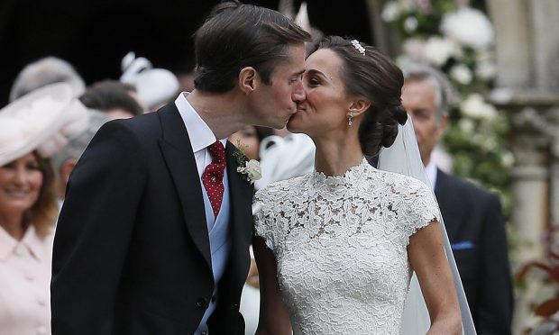 Pippa Middleton and James Matthews kiss after their wedding at St Mark's Church (Kirsty Wigglesworth - Pool/Getty Images)
