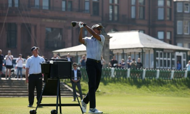 Barack Obama tees off at the first hole at St Andrews Golf Club (Andrew Milligan/PA Wire)