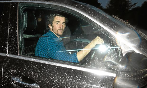 Joey Barton leaves training at the Rangers Football Centre (PA)