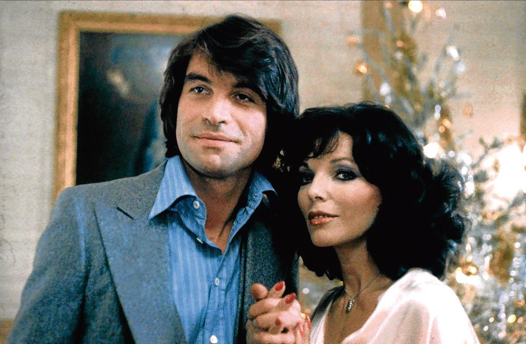 Joan alongside Oliver Tobias in The Stud, 1978 (Allstar/ARTOC FILMS)