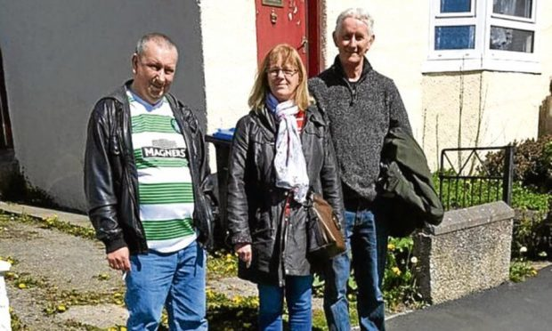 Tommy Chalmers, Pat McBain and Robert Weston, Right, outside the house in Turrif where their family lived