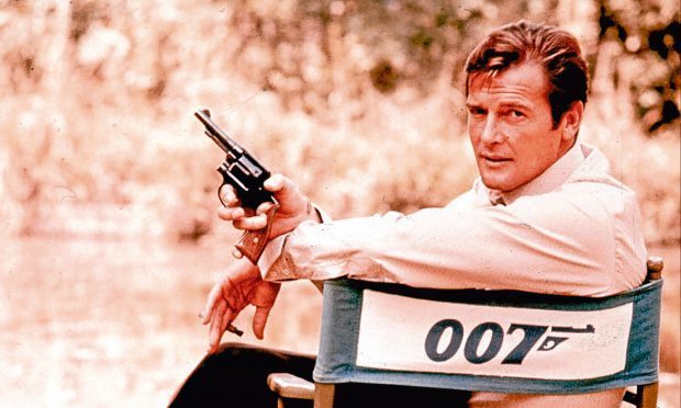 Roger Moore, playing James Bond in 1972 (AP Photo, File)