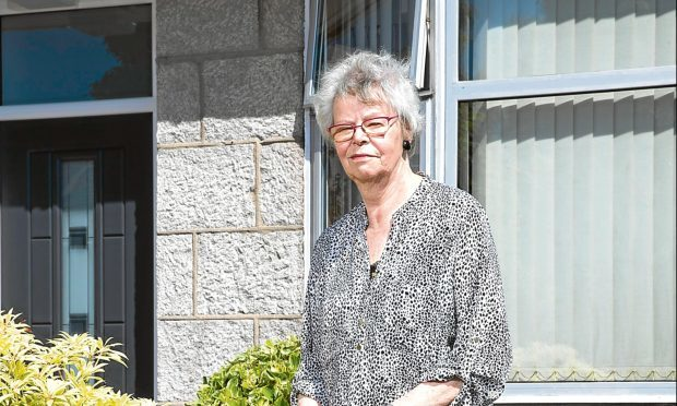Sheila Stephen was having problems with the external lights on her property in Aberdeen (Ross Johnston/Newsline Media)