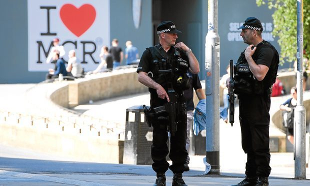 Armed police patrol the city centre ahead of a national minute's silence in remembrance of all those who lost their lives in the Manchester Arena attack (Leon Neal/Getty Images)