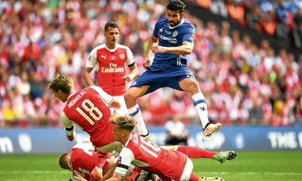 Diego Costa of Chelsea shoots as Nacho Monreal of Arsenal, Rob Holding of Arsenal attempt to block during The Emirates FA Cup Final between Arsenal and Chelsea at Wembley Stadium (Laurence Griffiths/Getty Images)