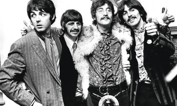 19th May 1967: The Beatles celebrate the completion of their new album, 'Sgt Pepper's Lonely Hearts Club Band' (John Pratt/Keystone/Getty Images)