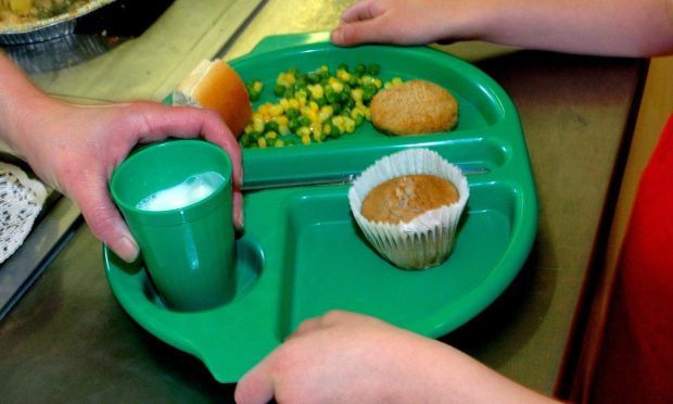Nick Clegg claims Theresa May's pledge to scrap free school lunches could deprive hundreds of thousands of pupils of their five-a-day intake (Chris Radburn/PA Wire)