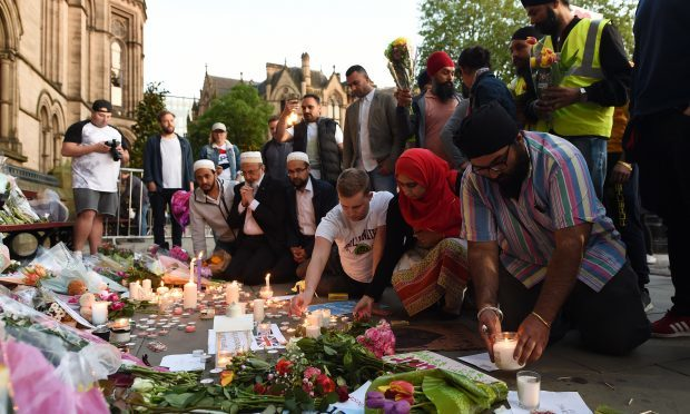 People leave tributes in Albert Square, Manchester (Joe Giddens/PA Wire)
