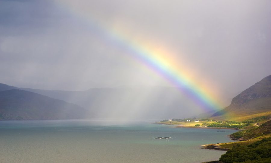 Rainbow lighting up Ardessie on Little Loch Broom in the highlands of Scotland (Getty Images)