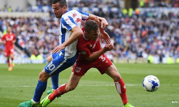 Tomer Hemed of Brighton and Hove Albion goes to ground after a challenge by Joe Bryan of Bristol City (Mike Hewitt/Getty Images)