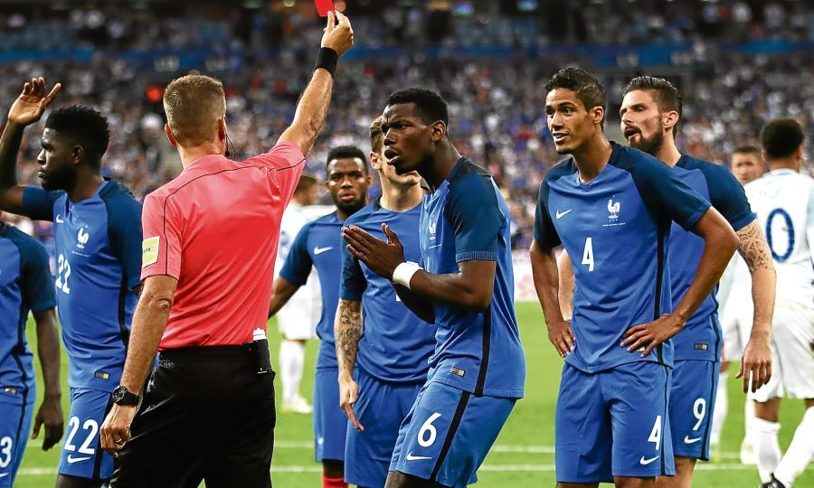 Paul Pogba reacts as Raphael Varane is shown the red card in the Stade de France (Julian Finney / Getty Images)