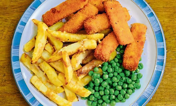 Traditional Fish fingers and Potato Chips, together with garden peas.