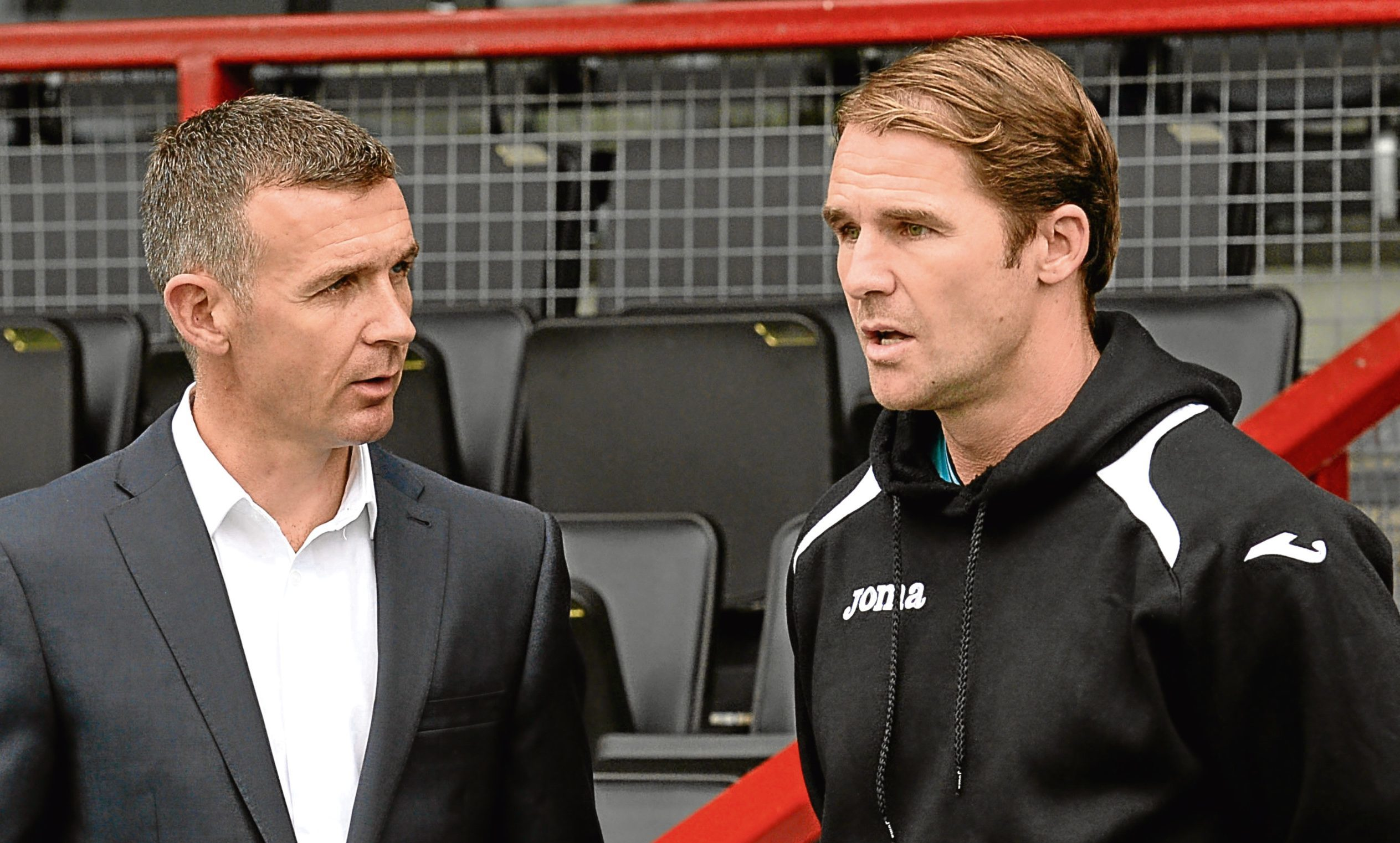 Ross County manager Jim McIntyre (left) chats with Partick manager Alan Archibald (SNS)
