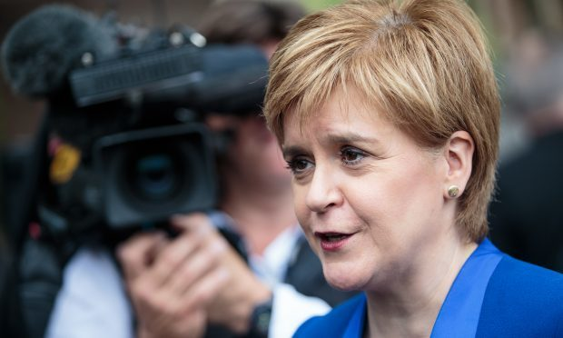 Scottish National Party Leader Nicola Sturgeon speaks to the media in Parliament Sq (Jack Taylor/Getty Images)