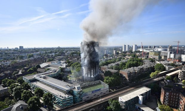 Smoke rises from the building after a huge fire engulfed the 24 story Grenfell Tower (Leon Neal/Getty Images)