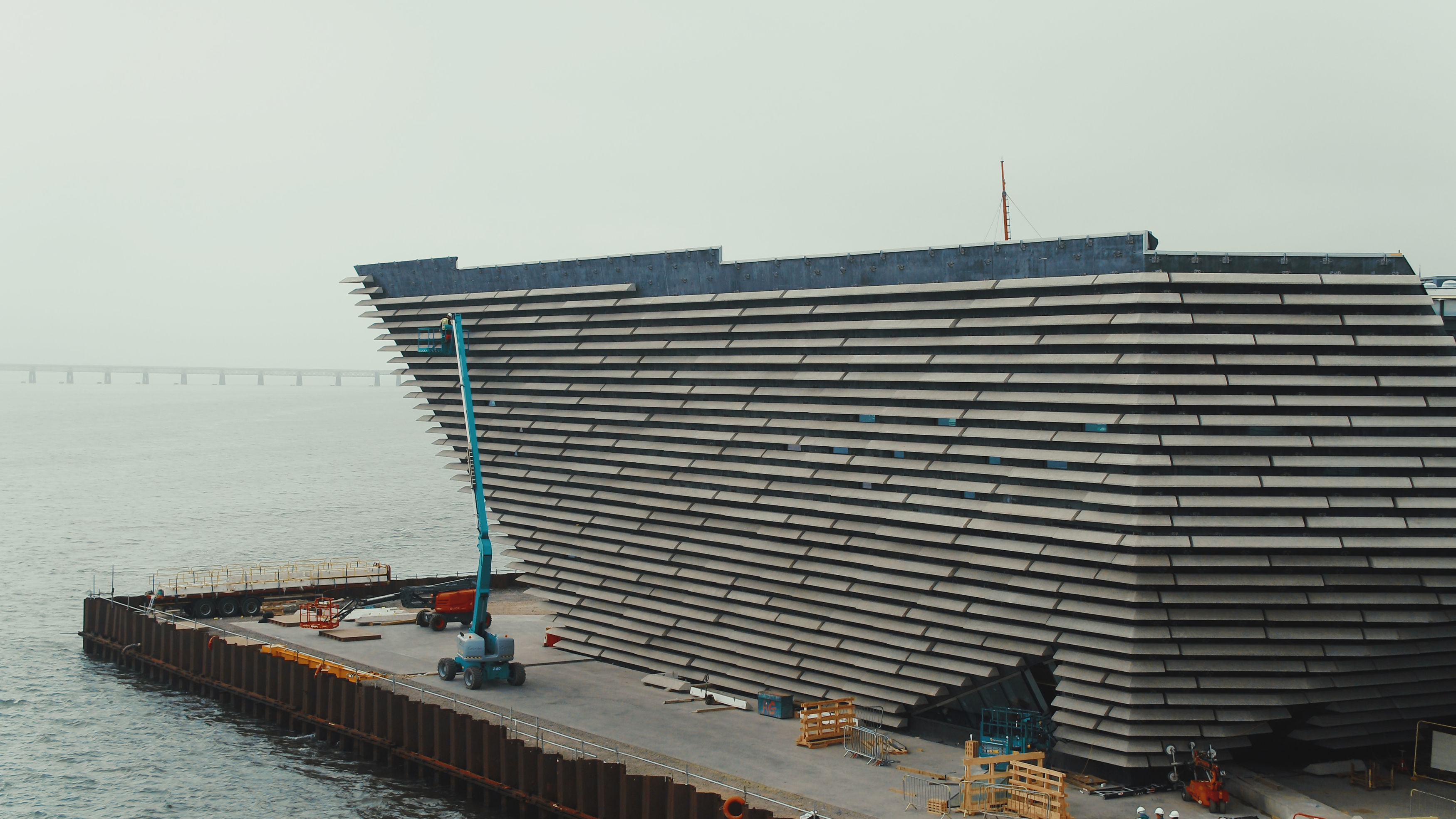 Huge cast stone panels being hung on the curving walls of Scotland's first design museum (V&A Dundee /PA Wire)