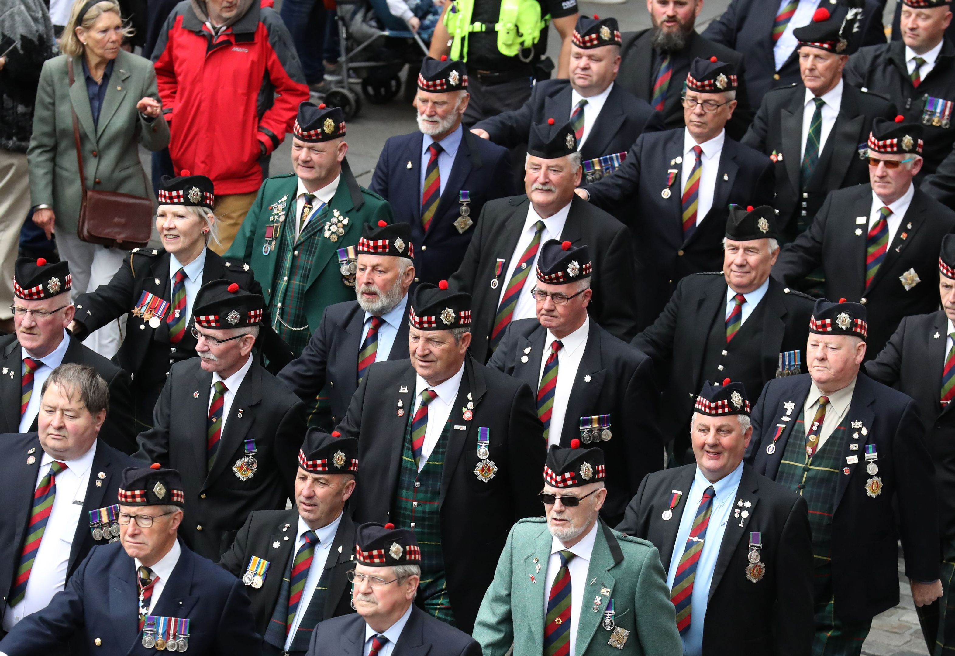 Ex-service personnel from Legion Scotland march down the Royal Mile during the ninth annual Armed Forces Day in Edinburgh (Andrew Milligan/PA Wire)