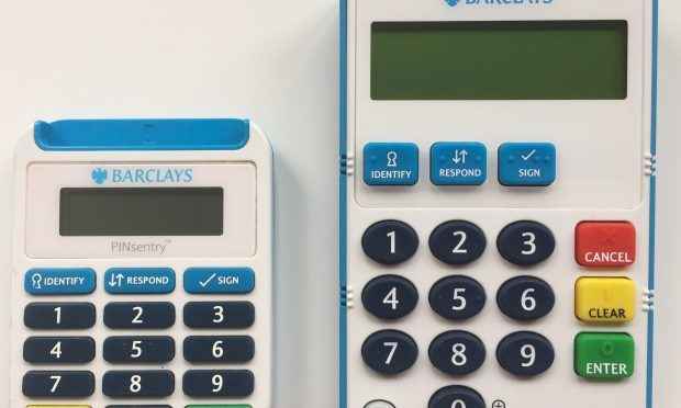 "A new talking card reader (right) with ""super-sized"" features to help customers with sight and dexterity issues to access its services more easily. (Barclays/PA Wire)"