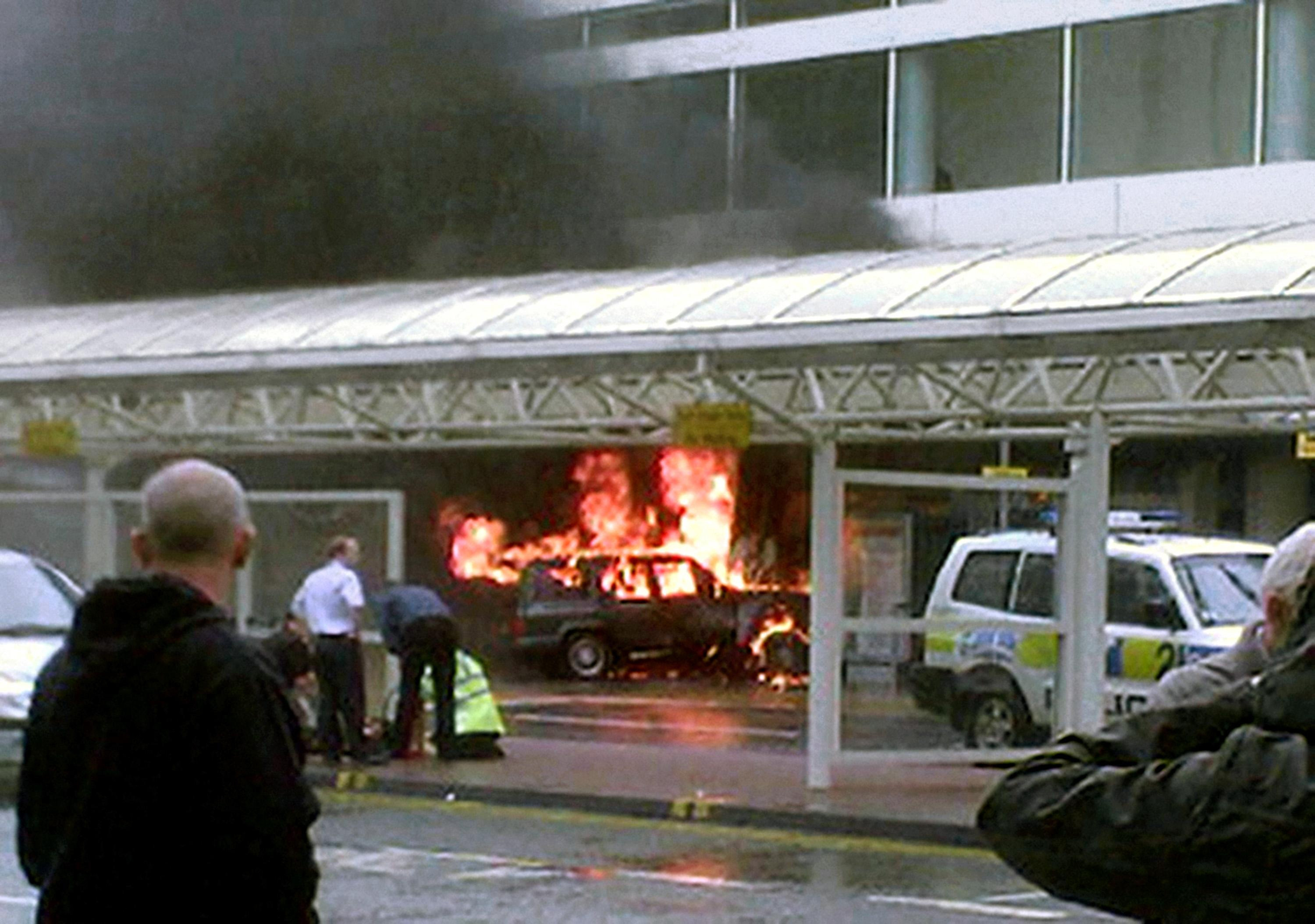 Flames rise from a Cherokee jeep after the terrorist car bomb attack on Glasgow airport (PA)