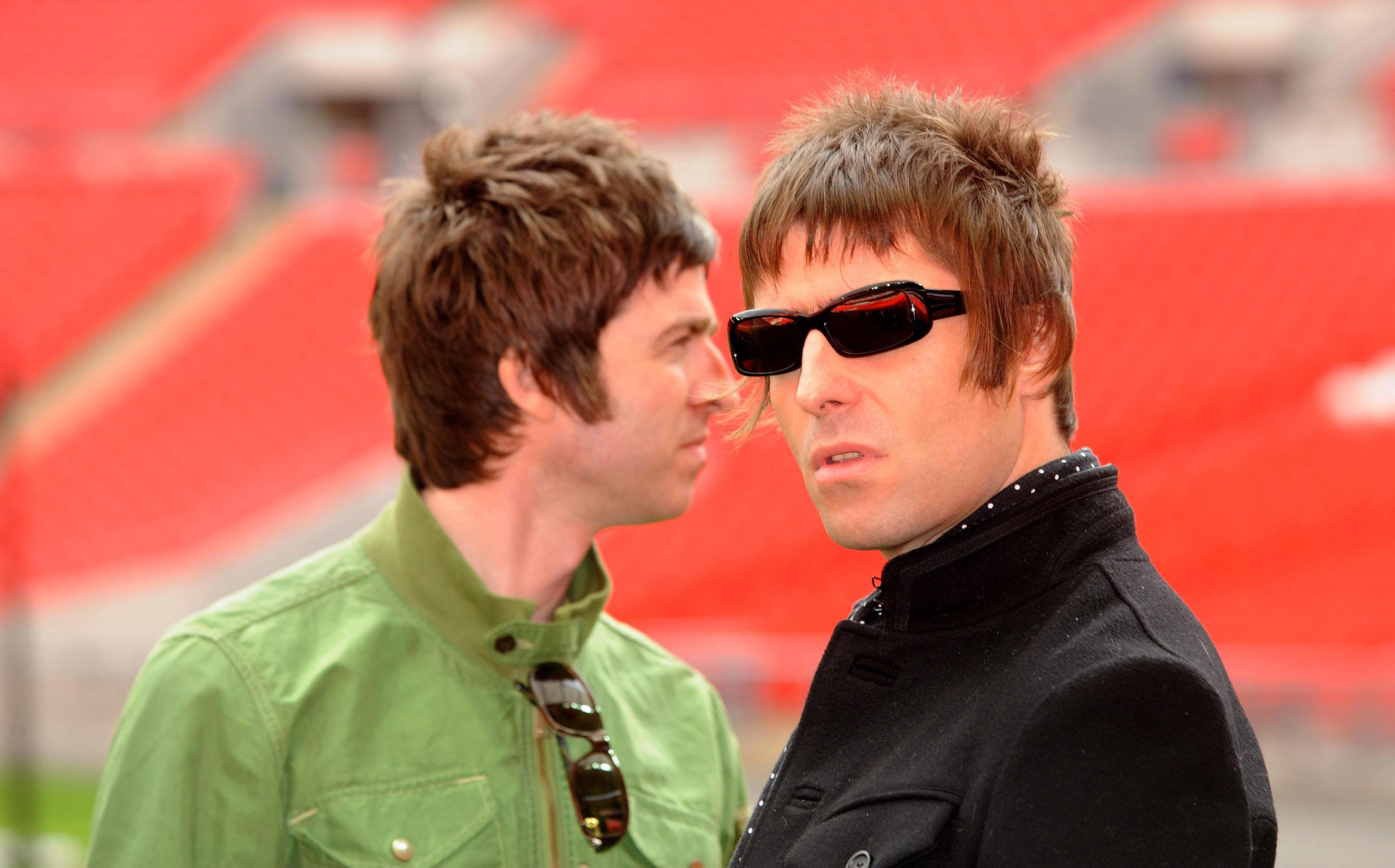 Noel Gallagher and Liam Gallagher (PA)