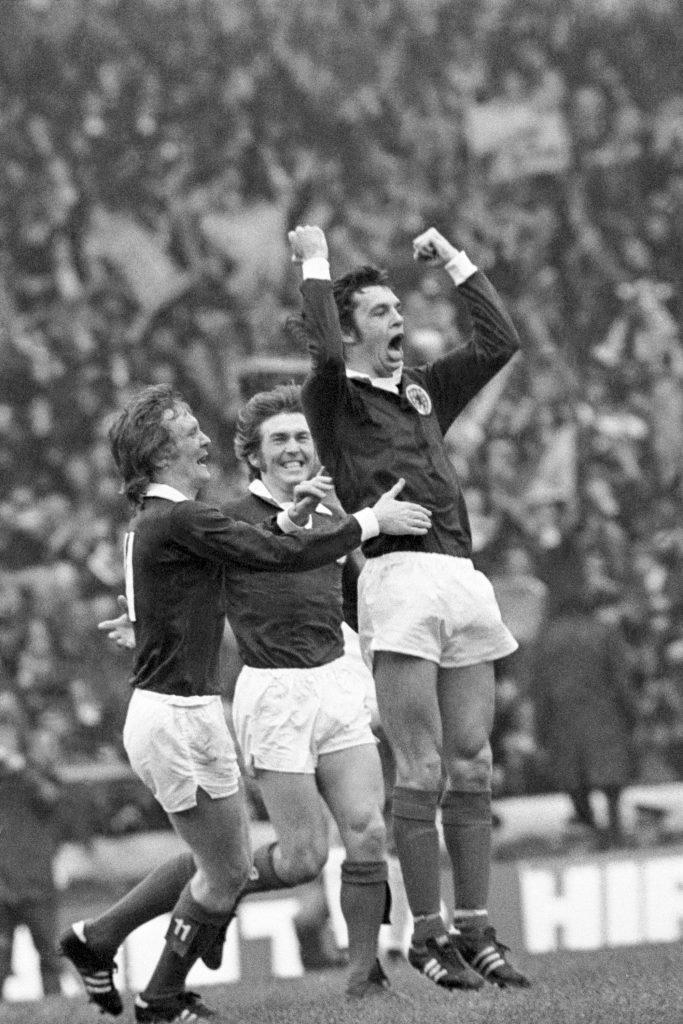 Kenny celebrates the opening goal in 1974 win with Davie Hay and Joe Jordan (PA Archive)