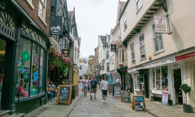 People walking on the street of the Shambles, inspiration of Diagon Alley in Harry Potter. (iStock)
