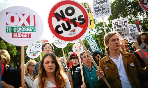 Protestors are seen outside the Houses of Parliament after the Chancellor of the Exchequer George Osborne delivered his Budget to the House on July 8, 2015 in London, (Dan Kitwood/Getty Images)