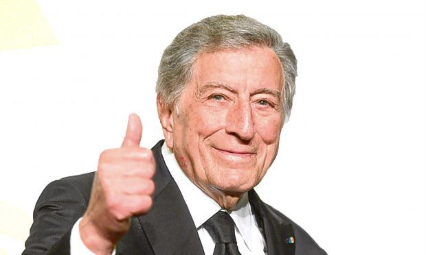 Singer Tony Bennett, winner of Best Traditional Pop Vocal Album for 'Cheek to Cheek,' poses in the press room during The 57th Annual GRAMMY Awards (Frazer Harrison/Getty Images)