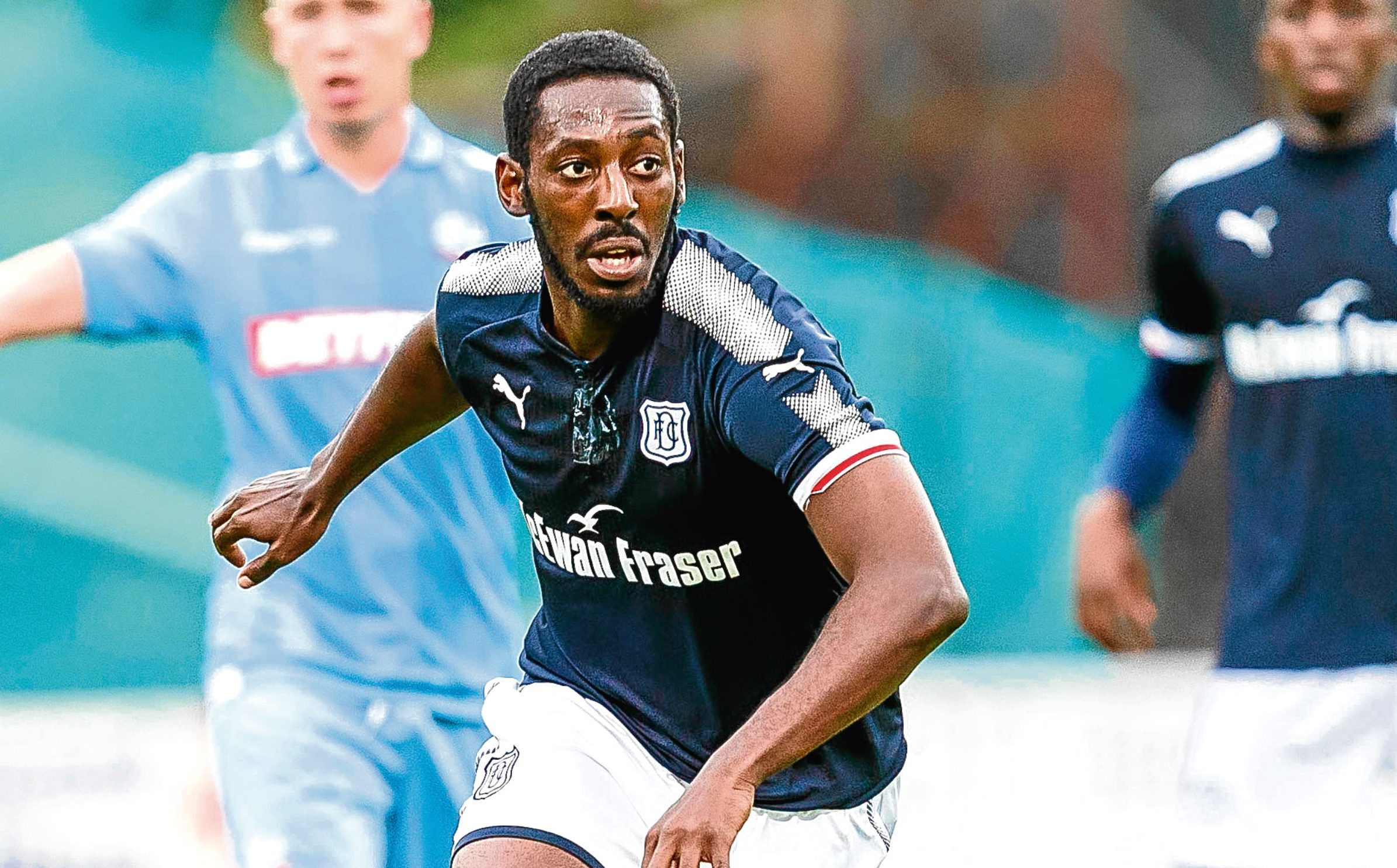 Roarie Deacon in action for Dundee (SNS Group)