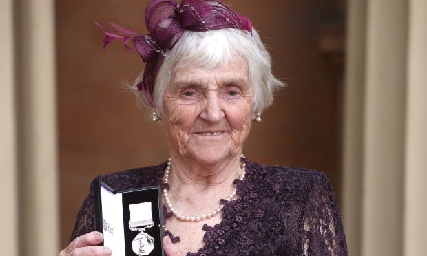Myrtle Simpson poses after she was awarded The Polar Medal by the Duke of Cambridge during an Investiture ceremony at Buckingham Palace (Jonathan Brady - WPA Pool / Getty Images)