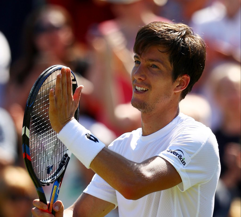 Aljaz Bedene of Great Britain acknowledges the crowd as he celebrates victory after the Gentlemen's Singles second round match against Damir Dzumhur of Bosnia and Herzegovinia on day three of Wimbledon (Michael Steele/Getty Images)