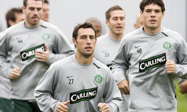 Celtic's Scott McDonald (centre) and Darren O'Dea (right) lead the way during training (SNS)