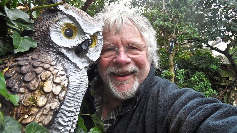 Birdwatcher Bill Oddie gives Hannah Stephenson a tour of his garden full of weird and wacky memorabilia (PA)