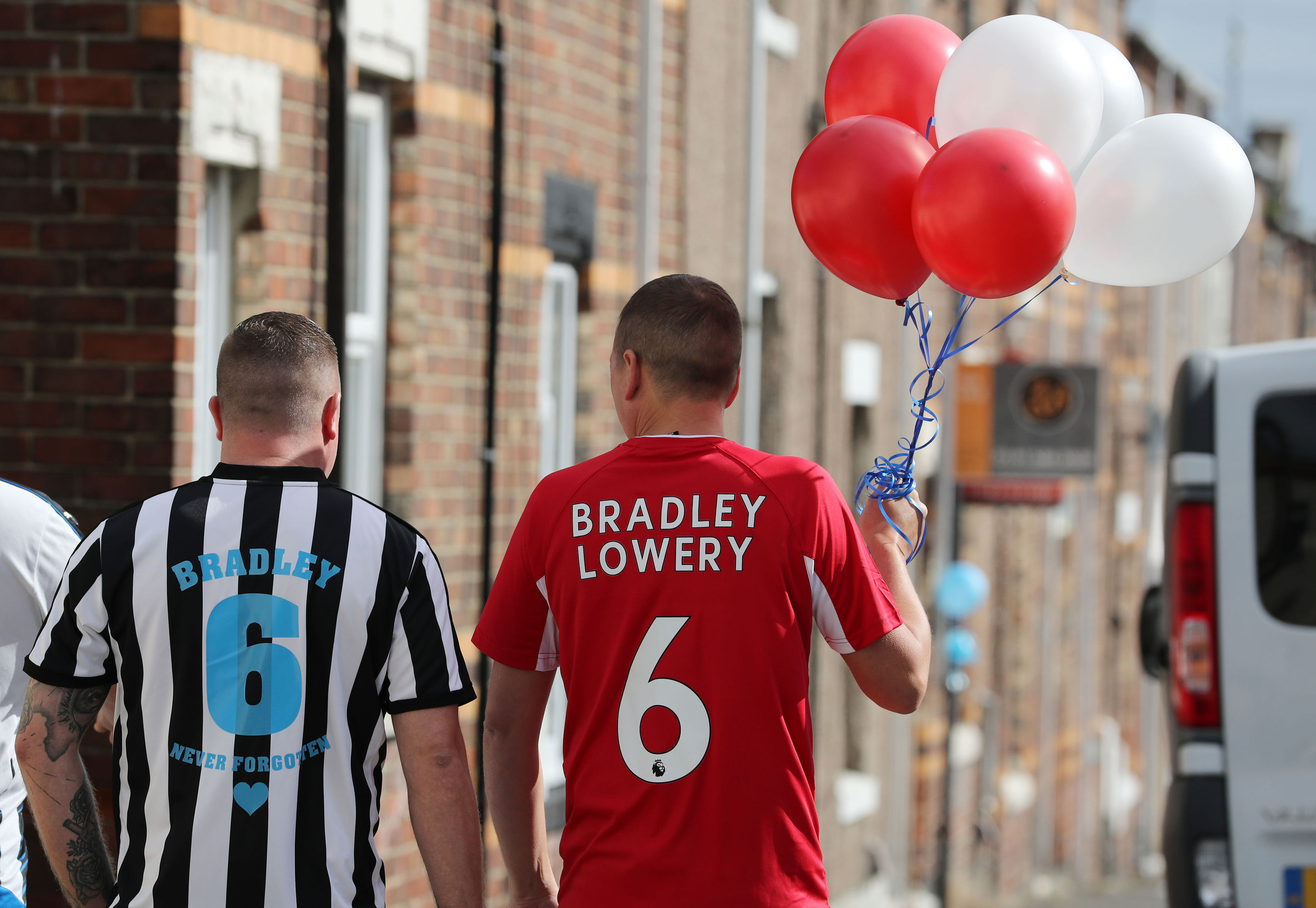 People line the route of the funeral procession with decorations ahead of the funeral of Bradley Lowery (Owen Humphreys/PA Wire)