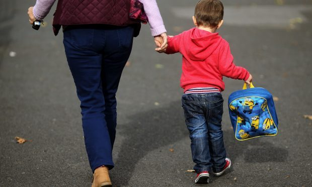 One in four mothers would have to give up work if they didn't have grandparents to look after their children, a new study reveals. (Niall Carson/PA Wire)