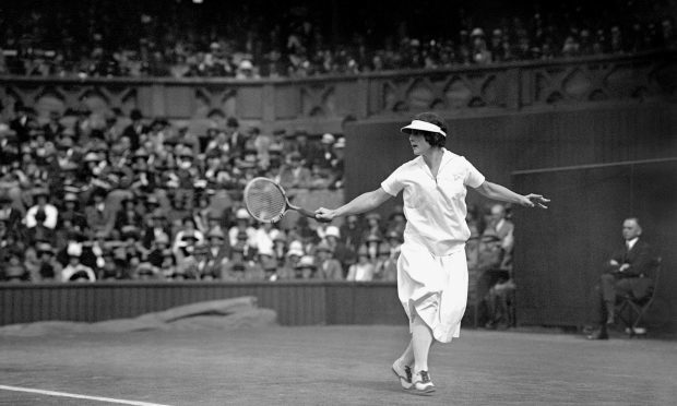 Helen Wills Moody in action - this time against Kathleen McKane in the Ladies tennis final at Wimbledon. (PA)