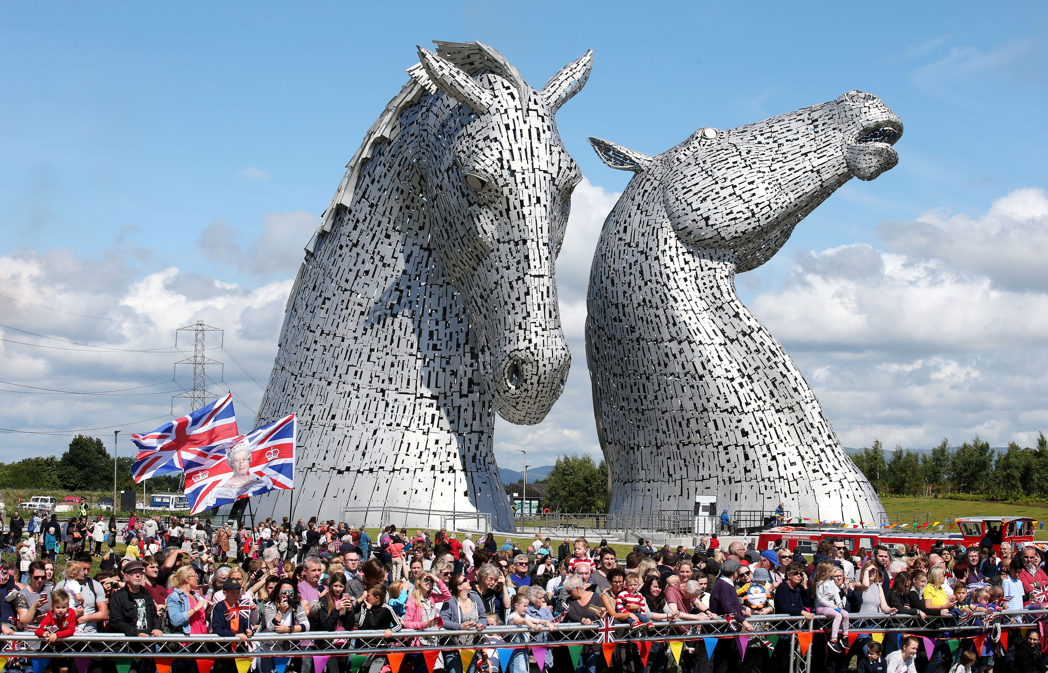 Crowds gather as Queen Elizabeth II and the Duke of Edinburgh visit The Kelpies (Andrew Milligan/PA Wire)
