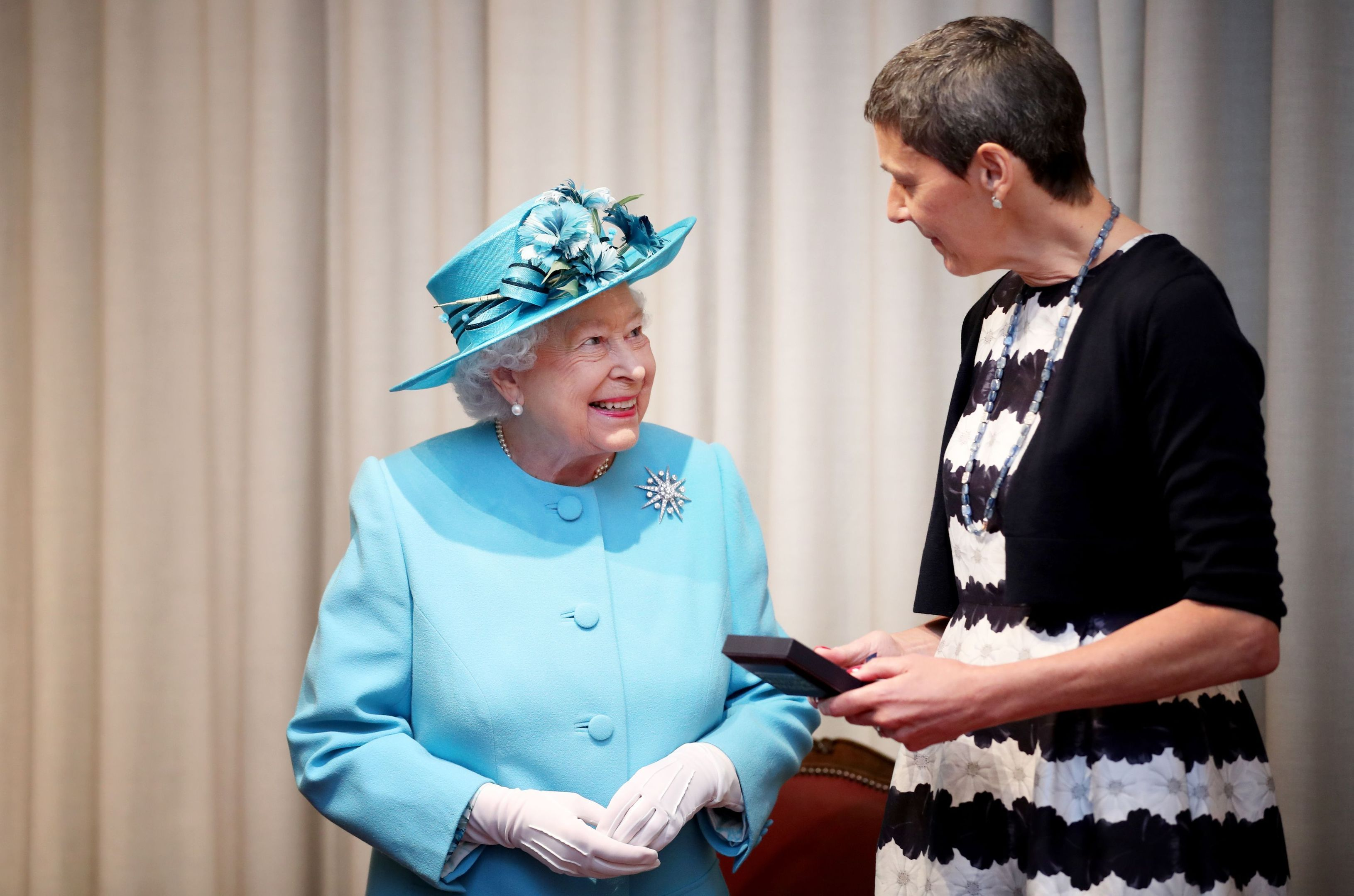 Queen Elizabeth II presents the Royal Medal to Professor Tessa Holyoake during a visit to the Royal Society of Edinburgh (Jane Barlow/PA Wire)