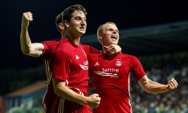 Aberdeen's Gary Mackay-Steven (right) celebrates his goal with Kenny McLean (centre) and Greg Tansey (SNS Group / Alan Harvey)