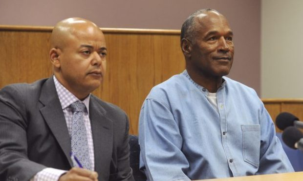 OJ Simpson appears with his attorney Malcolm LaVergne (left) via video for his parole hearing (Jason Bean/The Reno Gazette-Journal via AP)
