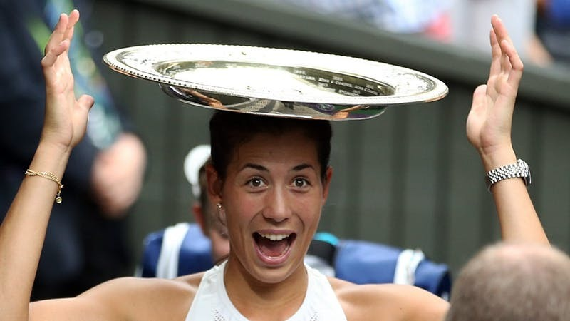 Garbine Muguruza won the women's title yesterday (PA)