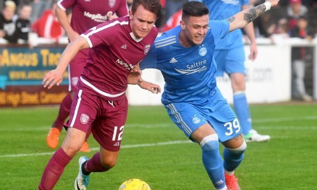 Arbroath's Jamie Henry and Aberdeen's Miles Storey (Chris Sumner)