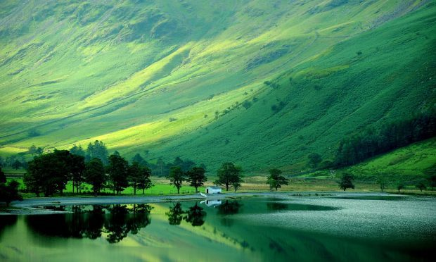 Early autumn reflections in Buttermere (Owen Humphreys/PA)