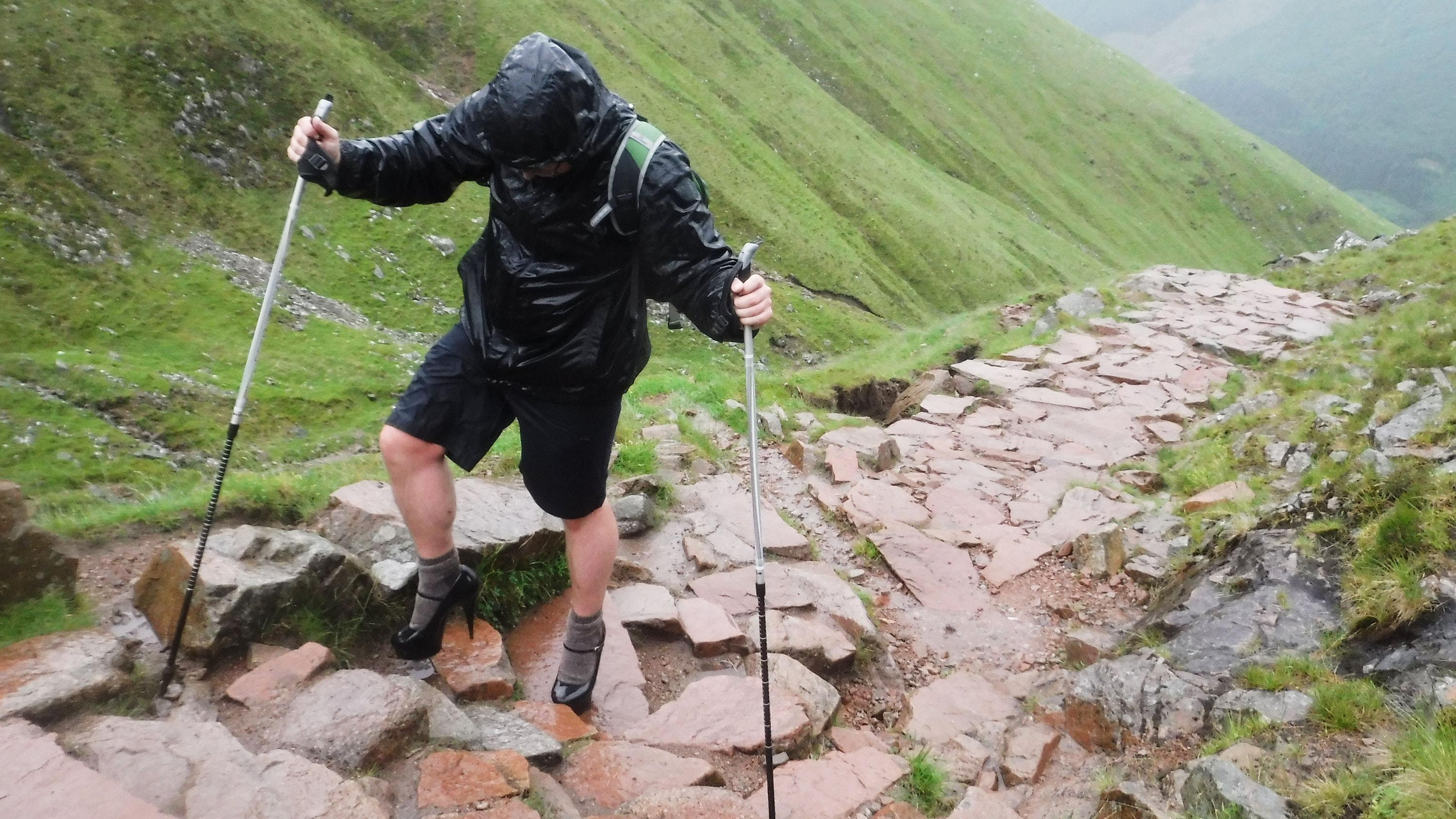 Ben Conway ditched his hiking boots to climb up Ben Nevis in a pair of five-inch heels (Callum MacKenzie Allen/PA)