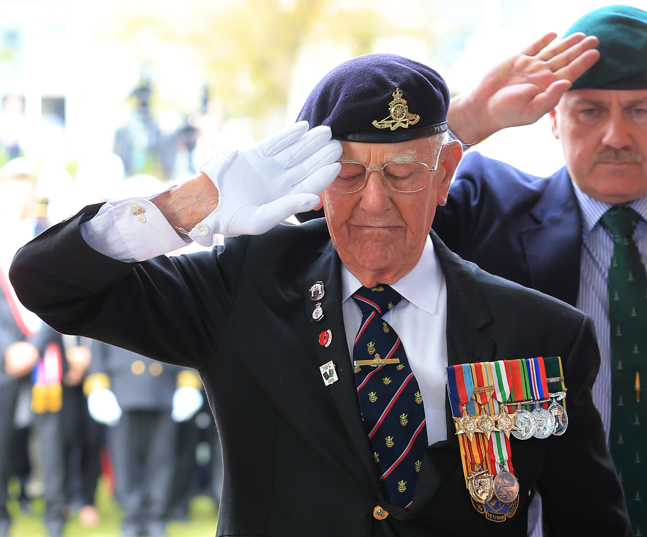 Dunkirk veteran Garth Wright (95) salutes after laying a wreath at the British Memorial in Dunkirk Military Cemetery, France, during a memorial service as part of the 75th anniversary commemorations of Operation Dynamo. (PA)