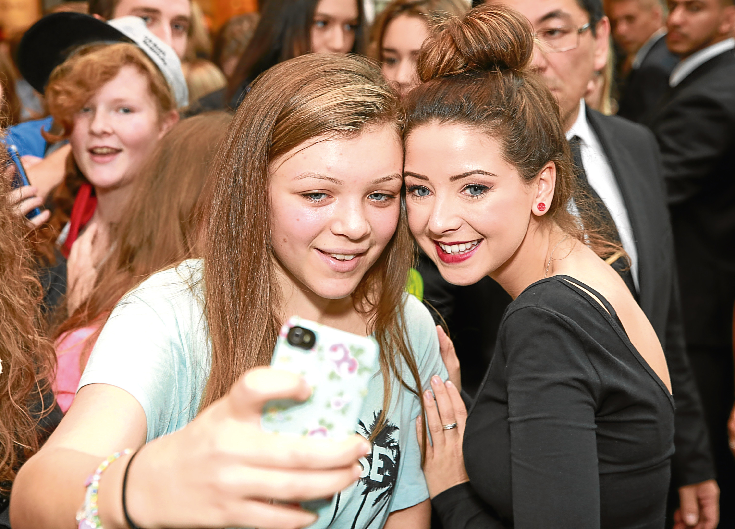 YouTube vlogger Zoella, real name Zoe Suggs, meets fans at the launch of her pop-up store at Westfield Stratford City in London (PA)